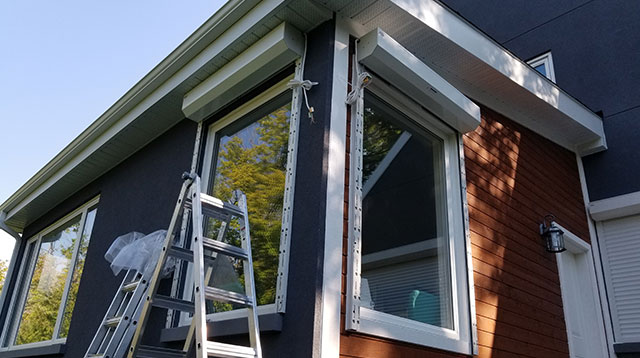 Exterior window roll up shutter installation