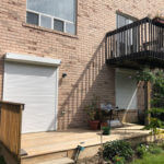 Backyard with closed roll shutters