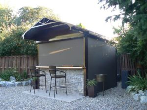 Backyard gazebo with roller screen