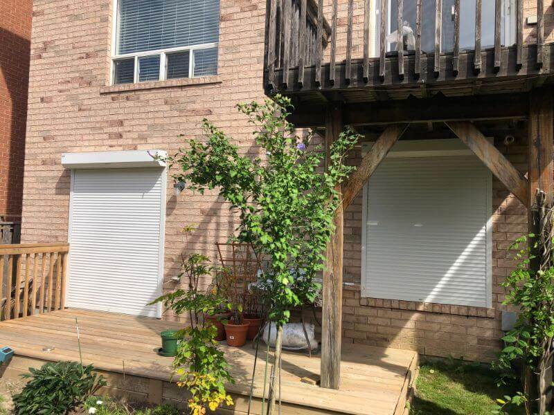 two roll up patio shutters