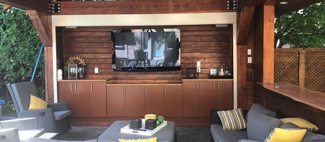 Outdoor tv enclosure with roll up gate
